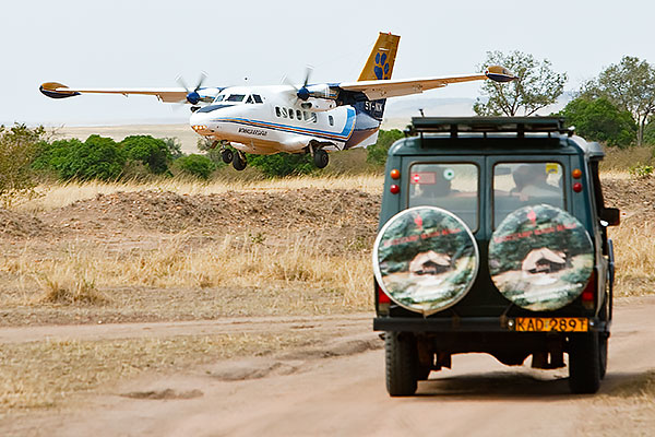 Safari truck and bush plane in Kenya's Masai Mara